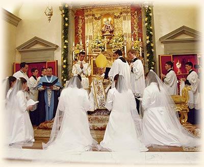 Postulants taking their vows