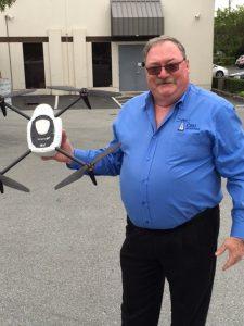 Glenn Smith, Vice President, CRU Adjusters, holds a Kespry Drone. (PRNewsfoto/Kespry)