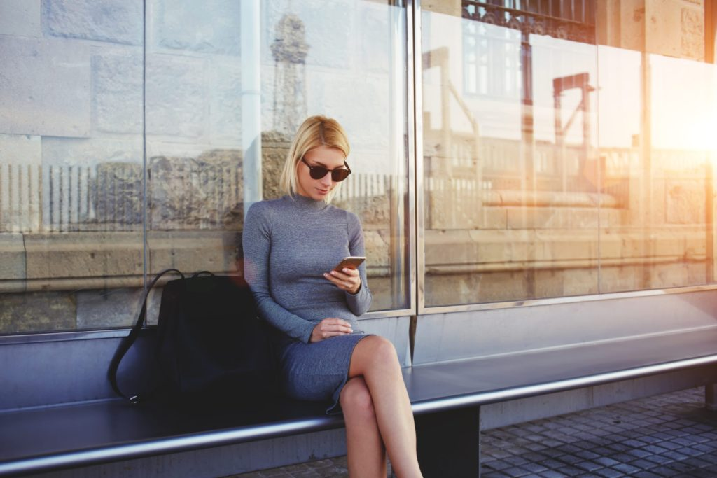 Benefits for Better Business Practices, woman on bench texting image