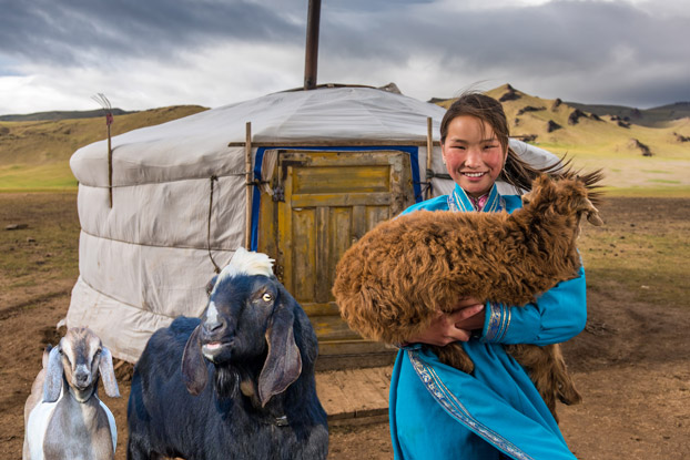 Mongolia Goats and girl - Universal Basic Income Stands Alongside the Ones in Need