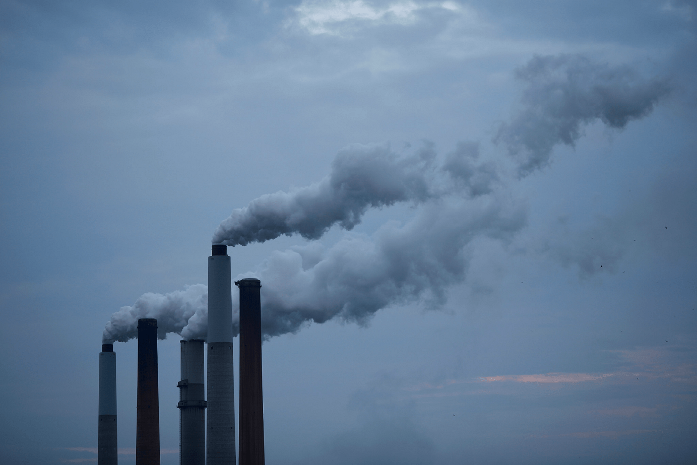 climate change chimneys - Tackling Climate Change: Central Banks Disappointment
