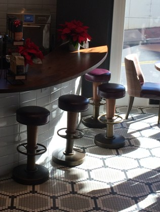 cafe scene with empty bar stools at a table