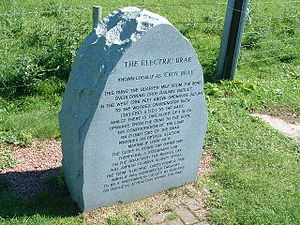 Electric Brae - stone marker describing Scotland's natural wonder of illuion