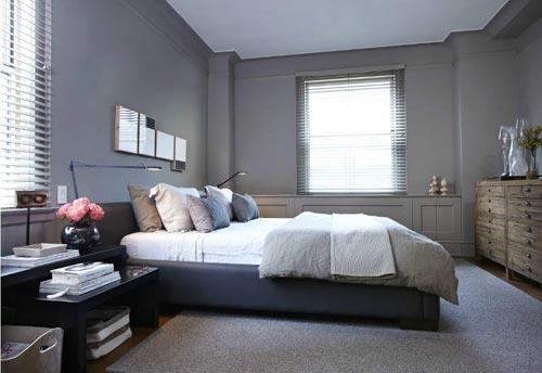 grijze slaapkamer met schuifdeur