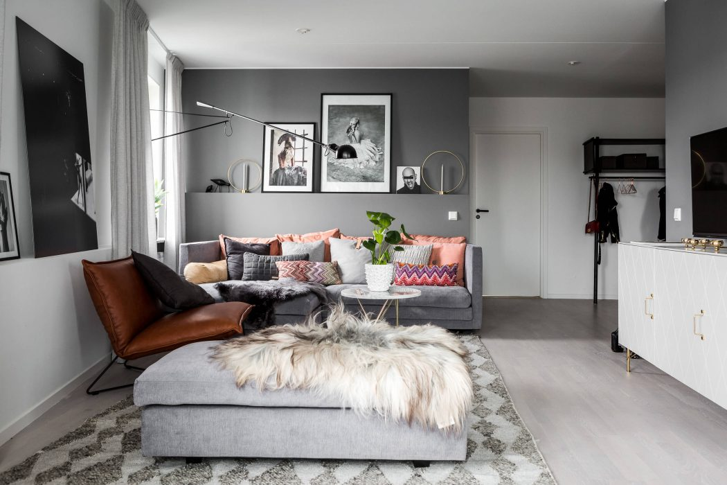 Een knus ingericht grijze woonkamer  Interieur inrichting