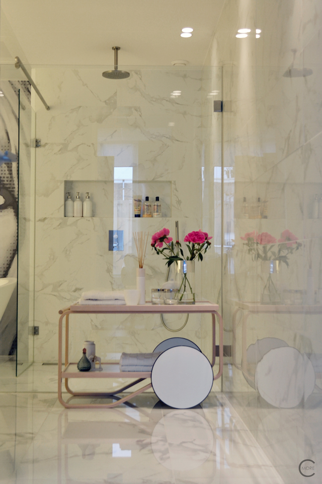 Vitra Design Kwartier Den Haag Studio van t Wout bathroom white marble pink trolley shower