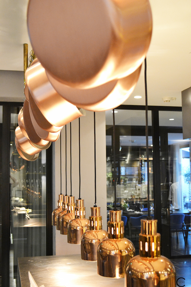Brass and copper lighting, pots and pans at the restaurant | The Pressroom | Ink Hotel Amsterdam | Tried + Tested | Design Hotel | Boutique Hotel | Picture © By C-More