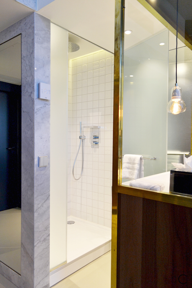 The Hotel bathroom with big rain shower and marble accents | brass gold walnut cabinet | Ink Hotel Amsterdam | Tried + Tested | Design Hotel | Boutique Hotel | Picture © By C-More