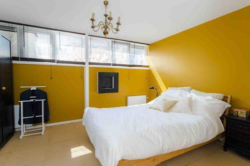 Interieur Inspiratie Slaapkamer met gele muren  Interieur