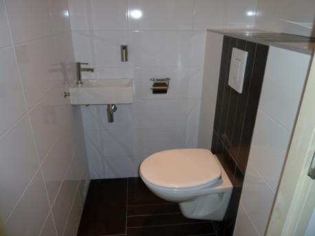 Een zwart wit toilet  Interieur Inspiratie
