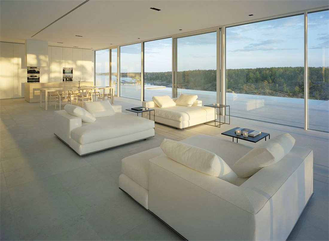 open kitchen dining and white sofa living space house sweden id1017