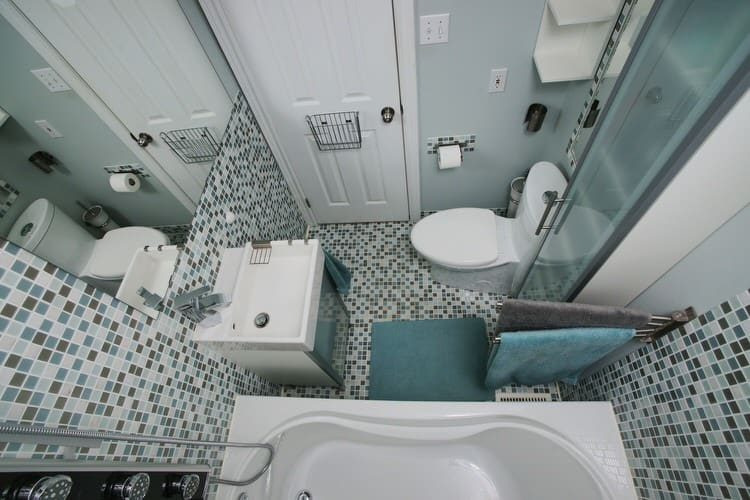 end up with a bathroom that looks too cramped for comfort