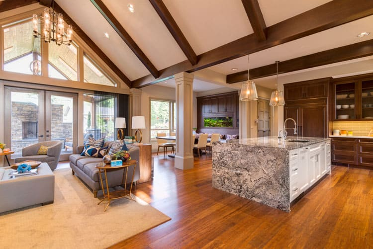 dark wooden floors living room ideas grey carpet 30 rooms with hardwood pictures the wood used for beams and kitchen cabinets grounds otherwise airy space while honey hued lend a warm sophistication