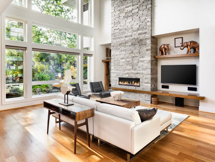 wooden floors in living rooms entertainment centre room 30 with hardwood pictures the blond ground this modern airy space white walls paired furnishings keep feeling light and clean while massive