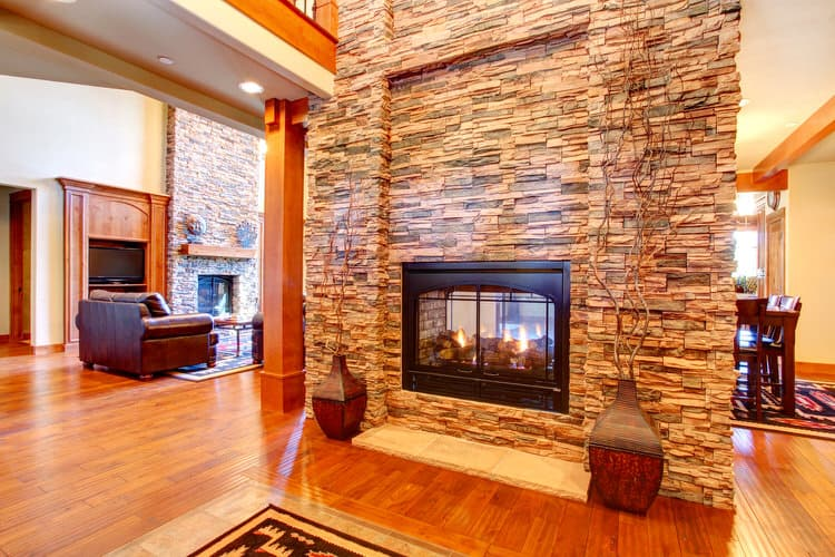 pictures of living rooms with stone fireplaces hgtv design ideas room 30 gorgeous walls multi color ledgestone runs from floor to ceiling in this however the wall is not actual it s a veneer product