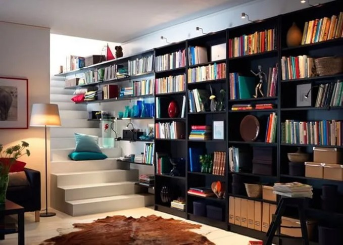If your hallways are wide enough, create some chic storage by adding bespoke bookshelves. Get extra style points for incorporating them into your staircase.