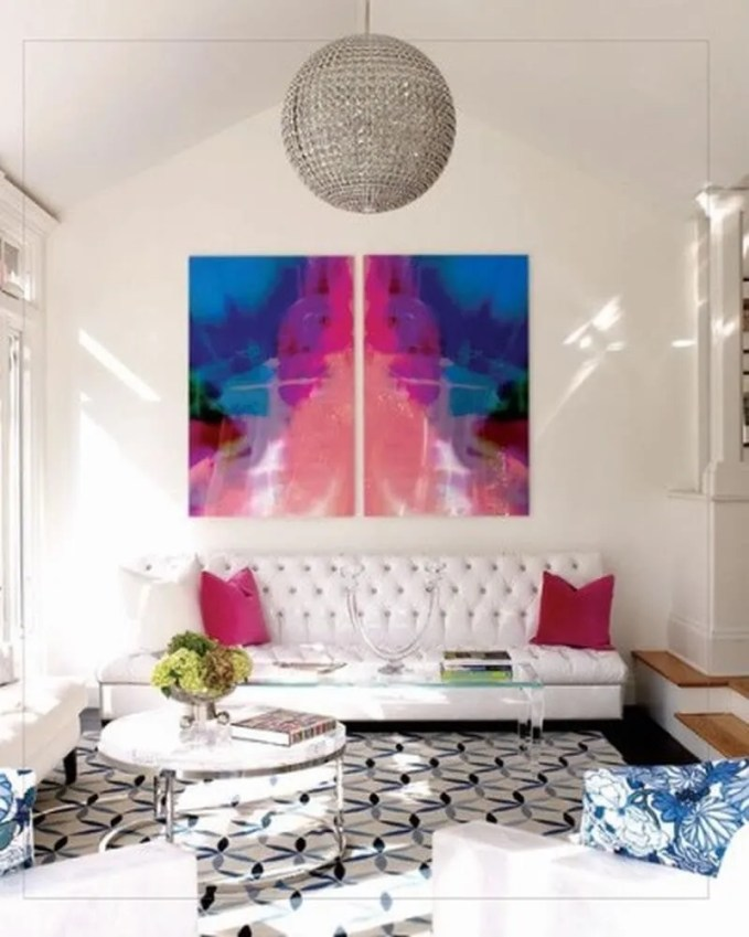 minimalist-living-room-with-colorful-art-and-pillows