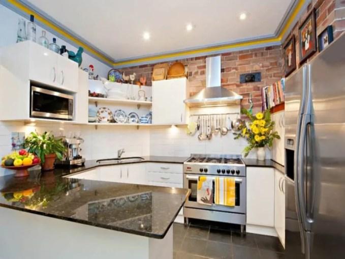 Bold Kitchen with Brick Walls