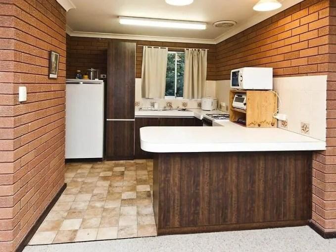 Sleek Kitchen With Brick Walls