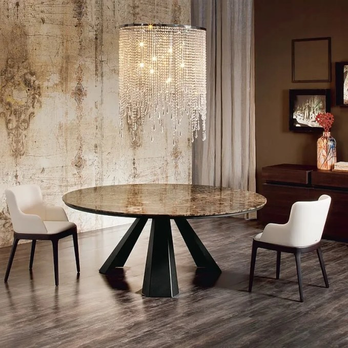 Small-round-dining-table-with-a-brilliant-chandelier-above
