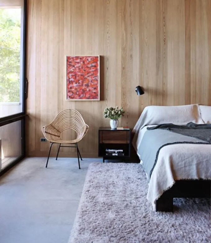 Chic Bedroom with Wood Paneling