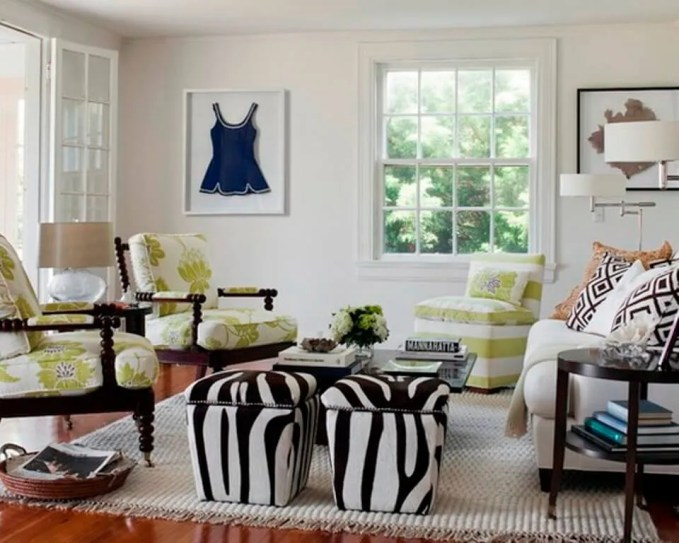 Feminine Living Room with Zebra otomans