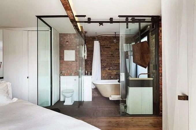 Glass Door Bathroom with brick walls