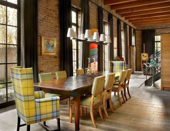 Tall Dinign Room With Brick Walls