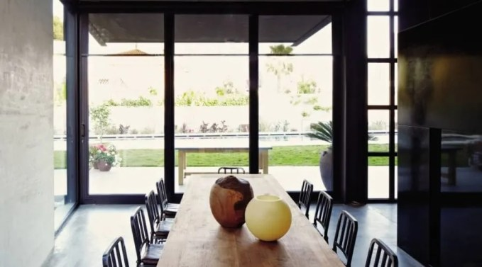 Contemporary Dining Room with Sleek Concrete Walls