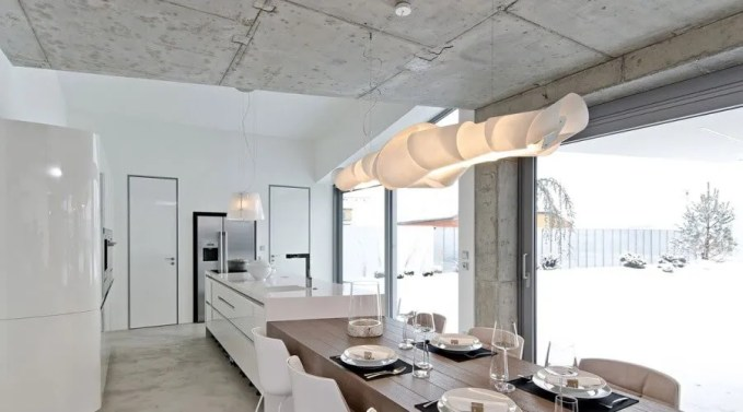 Luminous Dining Room with Concrete Wall