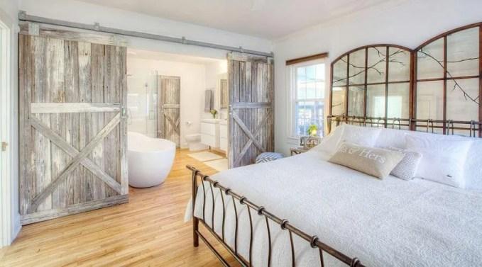 Farmhouse-style-bedroom-with-reclaimed-wood-barn-doors