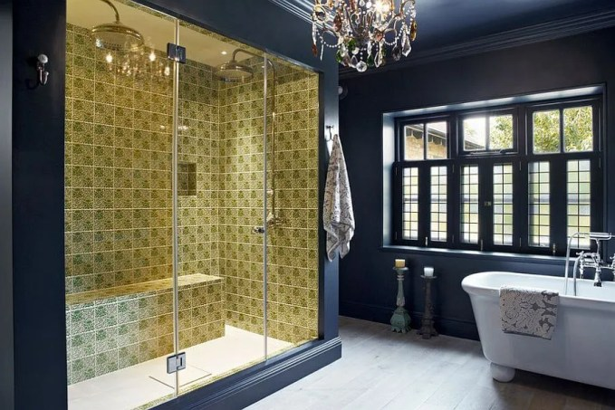 navy Blue Bathroom with glamorous chandelier