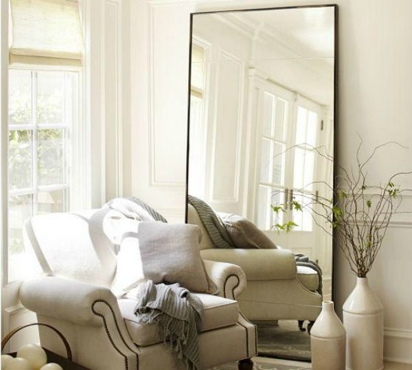 Spiegel in woonkamer  InteriorInsidernl