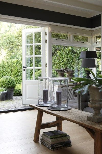Schuifdeuren naar tuin  InteriorInsidernl