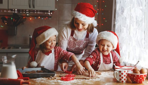 International Culinary Studio happy family mother and children son and daughter bake cookies for Christmas