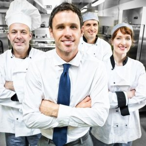Four Chefs in Industrial Kitchen