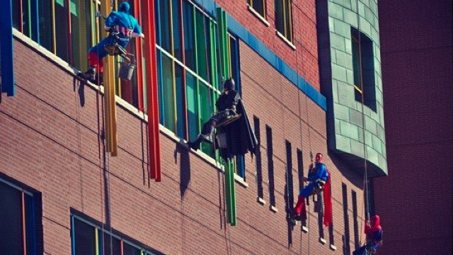 Window washers at Children's Hospital of Pittsburgh don costumes