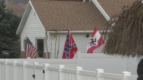 A man flew Nazi and Confederate flags outside his home and dozens of protesters showed up