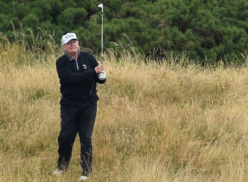 Trump spends day two of national emergency golfing snagging an omelette