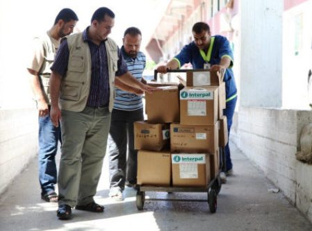 Interpal staff deliver vital medical aid to a Palestinian clinic