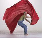 Theron waving red fabric