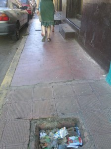 Huge hole in the sidewalk.  These were everywhere and presumably designed to cripple unwary tourists.