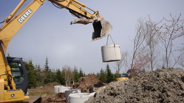 Lowering a Well Crock in Place