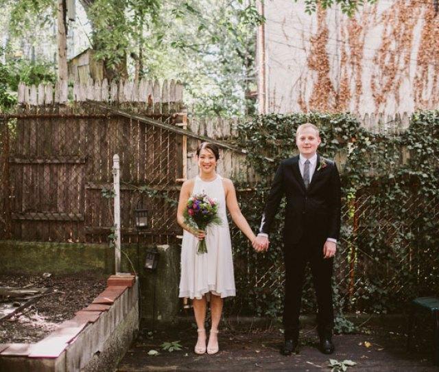 Bride And Groom Portrait In Backyard