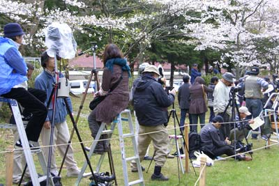 Photographers claim space horizontally and vertically along the course well before the running of the yabusame.