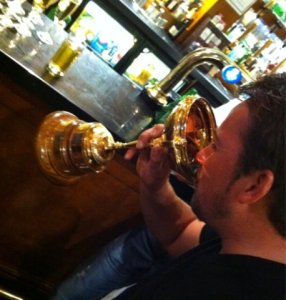 Graeme McDowell enjoys a drink from the Ryder Cup