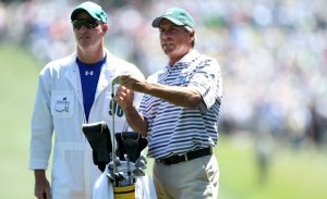 Caddie Joe LaCava discusses a shot with Fred Couples at the 2011 Masters Tournament