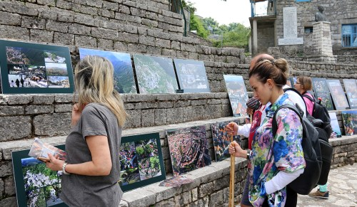 Openair exhibition in the square of a Greek village in Pindus Mountains