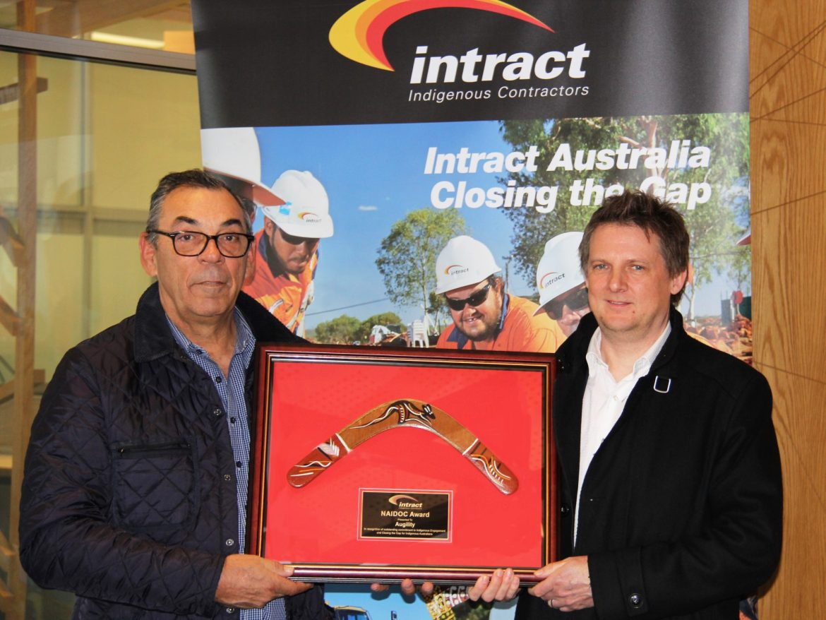 Intract team members winning an award at the NAIDOC Week in South Australia