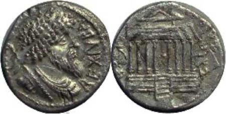 Monnaie de Juba Ier, roi des Numides. Il porte une coiffure constituée de tresses et une barbe taillée en pointe typiquement berbère. D. R.